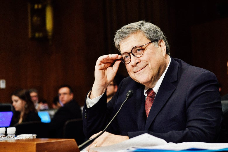 Attorney General William Barr smiles and adjusts his glasses while testifying before the Senate Judiciary Committee on Wednesday in Washington.