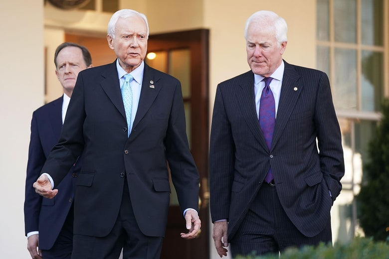 WASHINGTON, DC - NOVEMBER 27:  Senate Finance Committee members Sen. Pat Toomey (R-PA) (L) and Sen. John Cornyn (R-TX) (R) walk out of the West Wing with Chairman Orrin Hatch (R-UT) following a lunch meeting with U.S. President Donald Trump at the White House November 27, 2017 in Washington, DC. Senate Republicans hope to pass tax reform and tax cut legislation this week and move closer to Trump's goal of signing it before the end of the year.  (Photo by Chip Somodevilla/Getty Images)