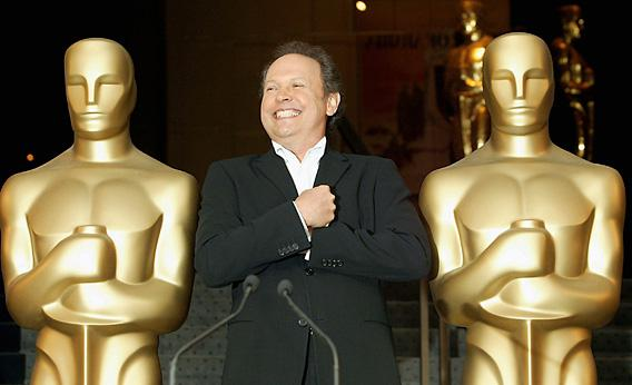 Actor Billy Crystal mimics the Oscar statues at the Academy of Motion Picture Arts and Sciences