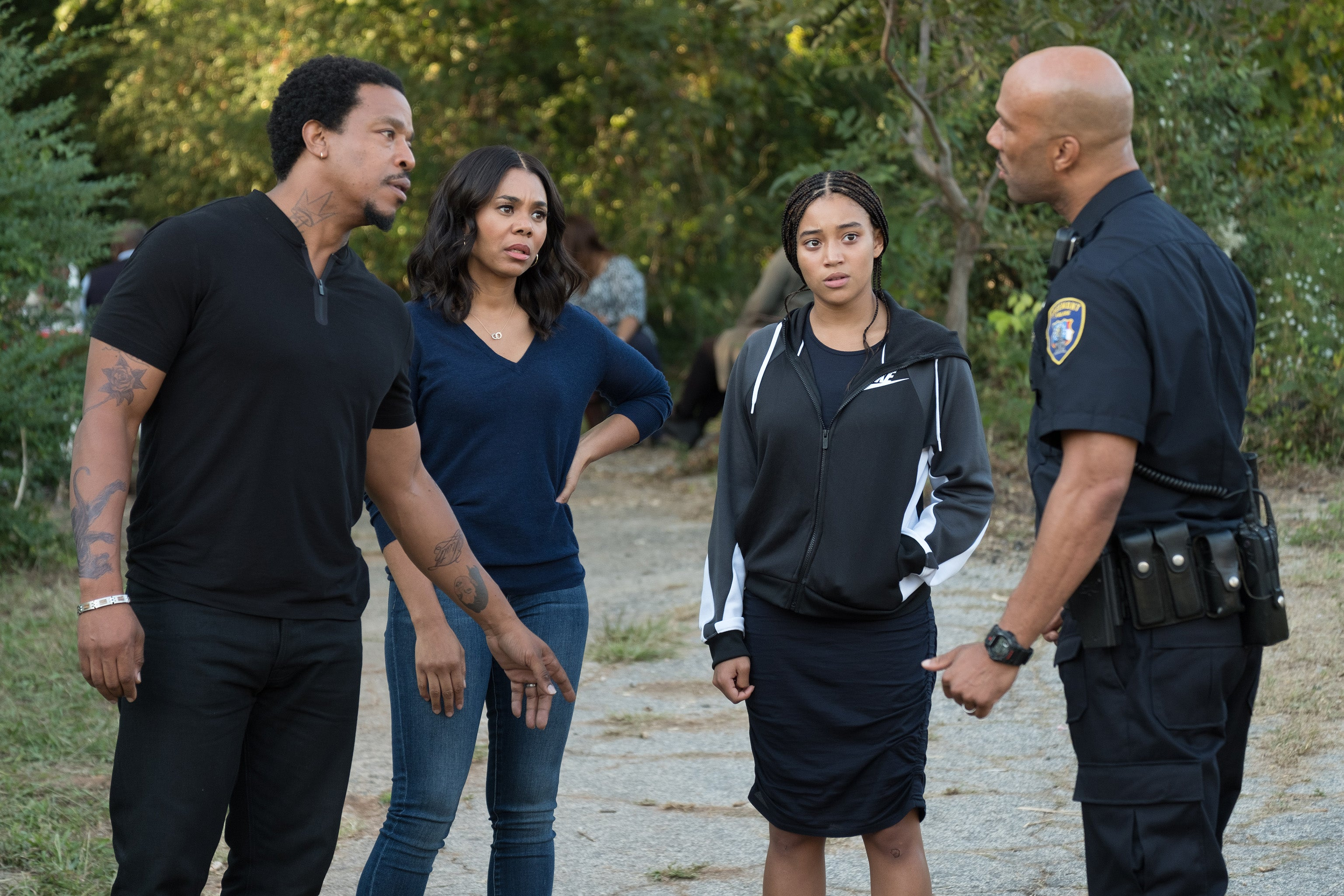 Russell Hornsby, Regina Hall, Amandla Stenberg, and Common. Common wears a navy police uniform.