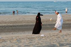 Omanis playing soccer on the beach. Click image to expand.