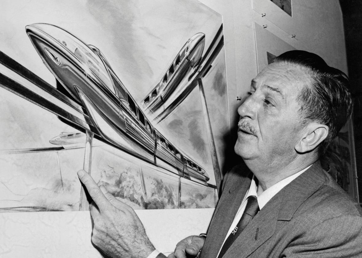 Walt Disney examines an artist's drawing of the futuristic Monorail system which will be in operation at Disneyland.