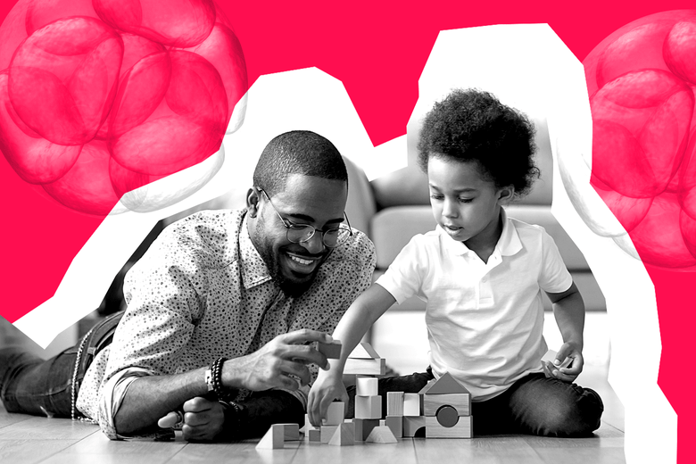 A man playing with blocks with his 6-year-old son, with imagery of embryos in the background.