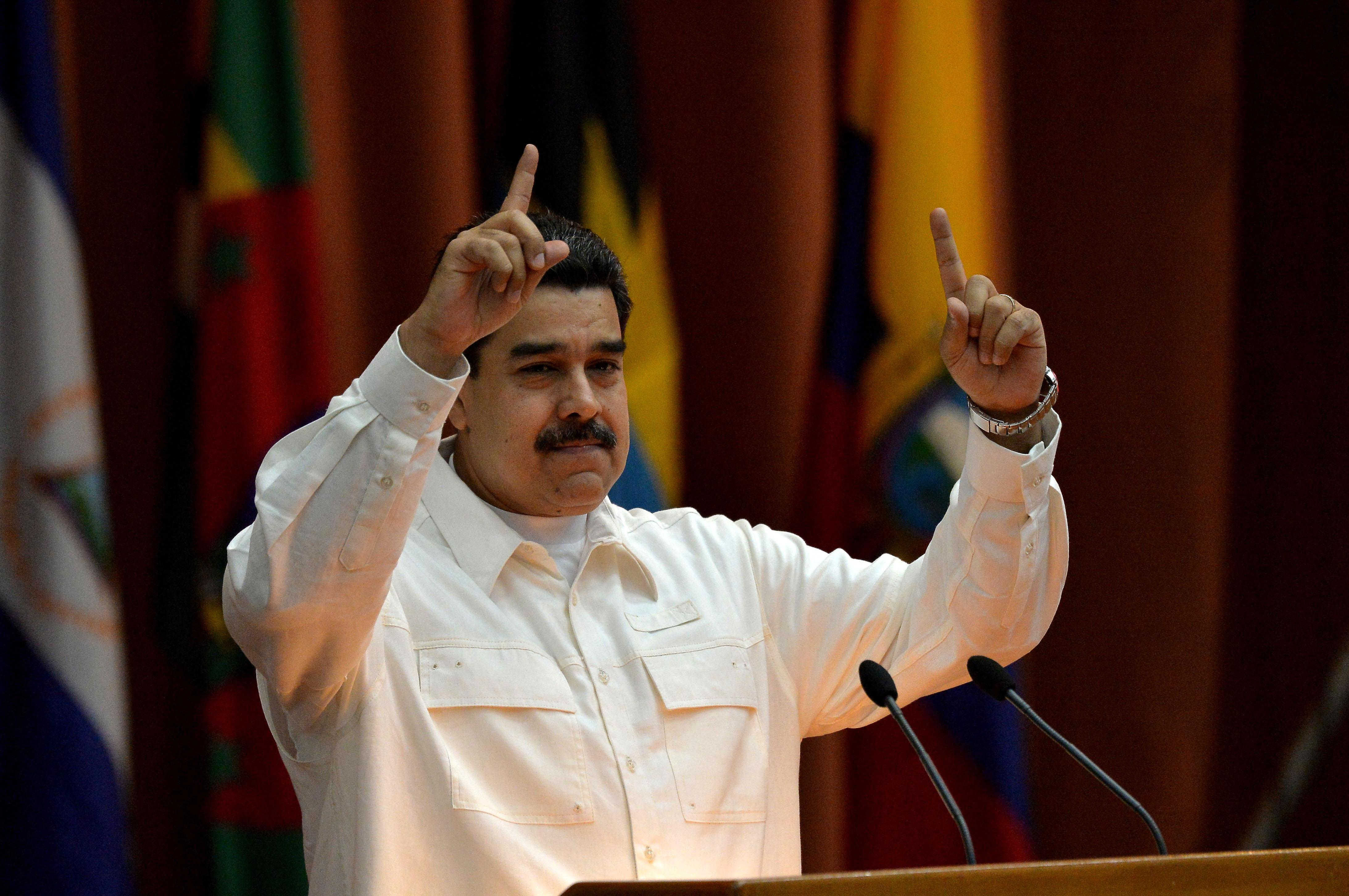 Venezuelan President Nicolas Maduro speaks at the closing ceremony of the XVI Political Council of the Bolivarian Alliance for the People of Our Americas (ALBA) at the Convention Palace in Havana, on December 14, 2017. / AFP PHOTO / YAMIL LAGE