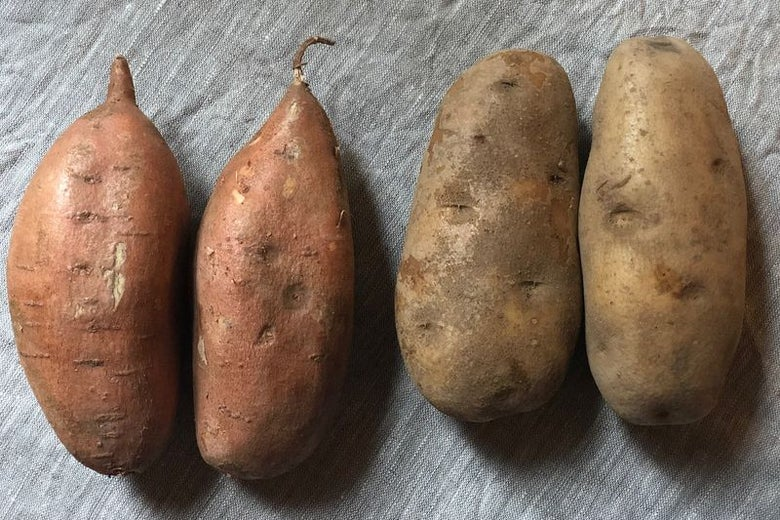 On the left, two sweet potatoes. On the right, two white potatoes, roughly the same size.
