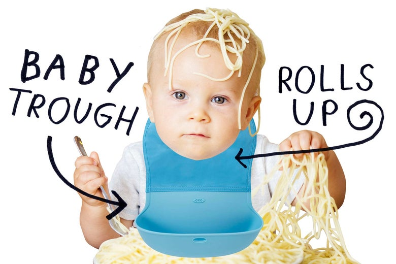 Baby covered in spaghetti wearing miraculous bib that has a trough.