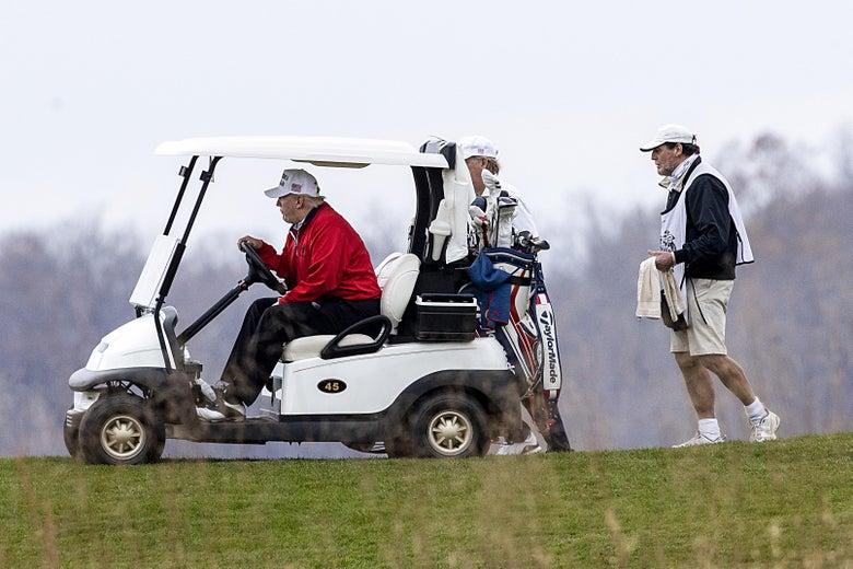 President Donald Trump golfs at Trump National Golf Club on November 21, 2020in Sterling, Virginia.