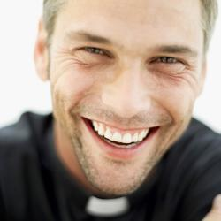 Portrait of a smiling priest.