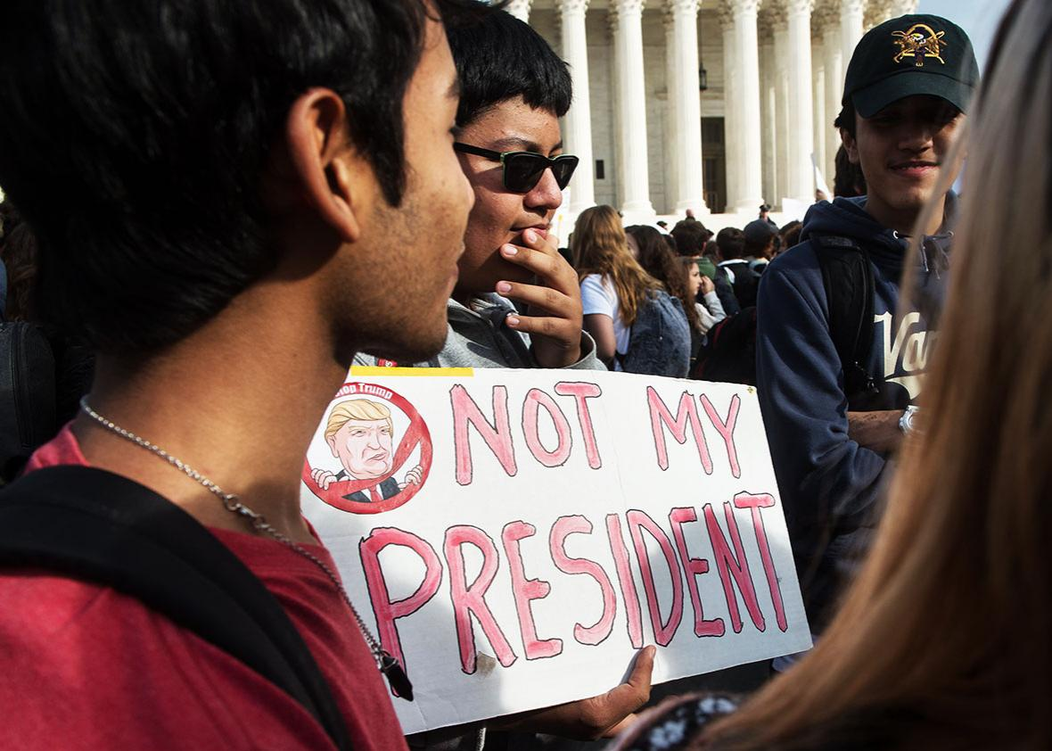 Secondary school students gather in front of the Supreme Court in Washington, DC, on November 15, 2016 as they protest the election of US President-elect Donald Trump.