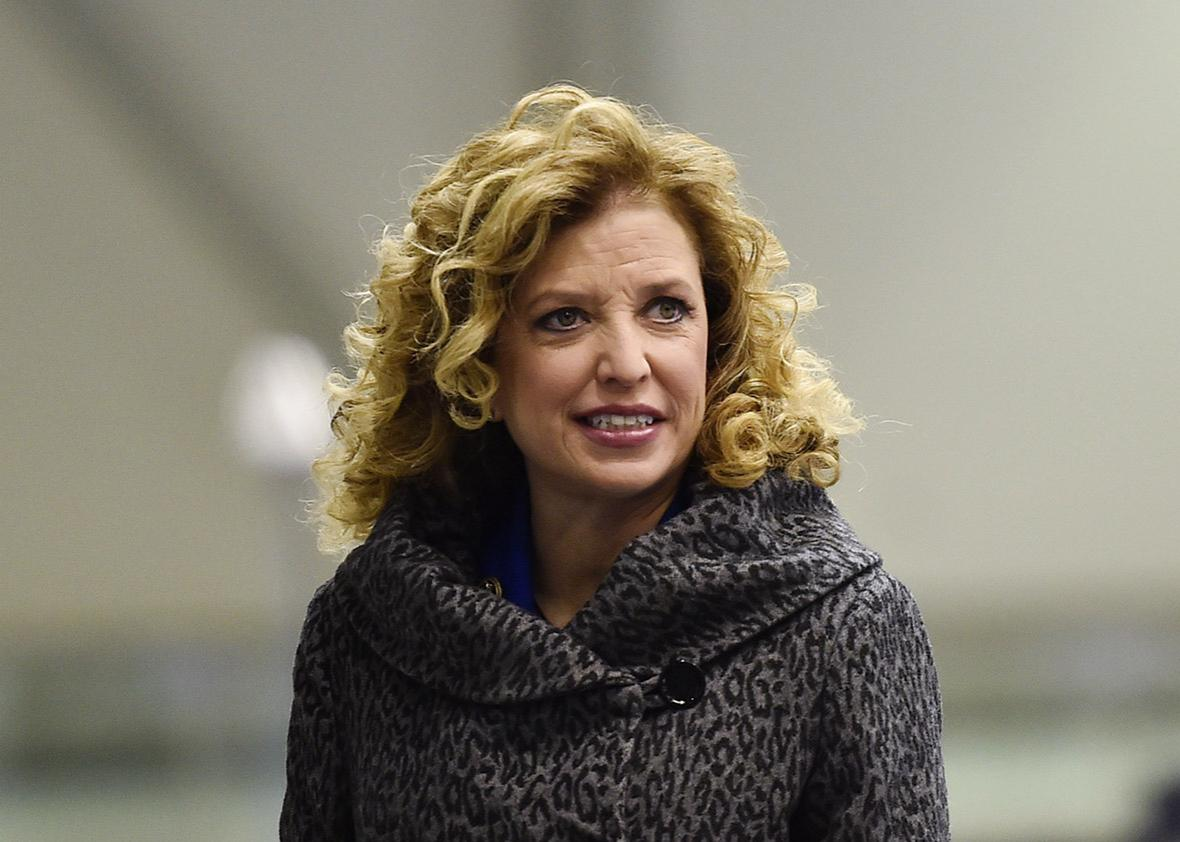 Democratic National Committee chair Debbie Wasserman Schultz stands in the media filing room before the Democratic presidential candidates debate at Saint Anselm College in Manchester, New Hampshire, December 19, 2015.