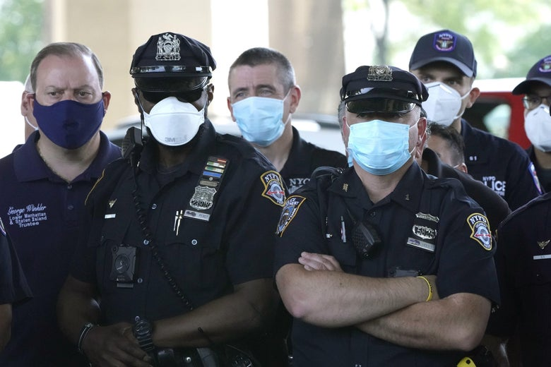 A crowd of police officers wearing masks