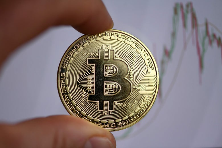 The photo shows a physical imitation of a Bitcoin.