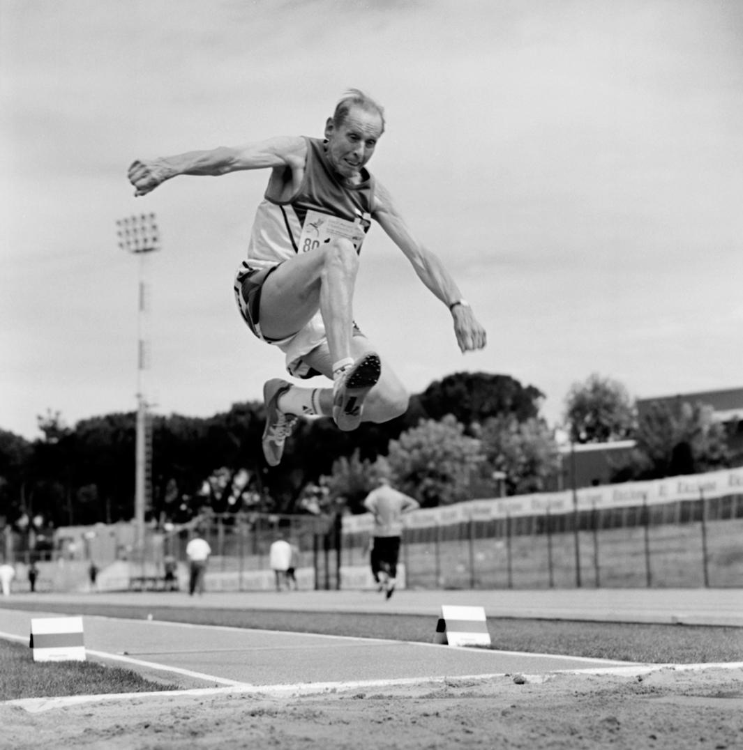 A senior long jumper in the 80-84 age bracket.  2007 World Masters Championships Stadia. Riccione, Italy. 2007.