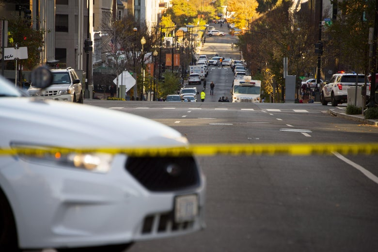 Police cars line 19th Street NW in Washington, DC, November 16, 2015, during a barricade situation. The Washington post reported that police said a woman fired a shot in the area around midnight and it turned into a barricade situation inside an office building. No one was injured but situation caused a major traffic snarl during the morning rush hour in downtown DC.  AFP PHOTO / JIM WATSON        (Photo credit should read JIM WATSON/AFP/Getty Images)