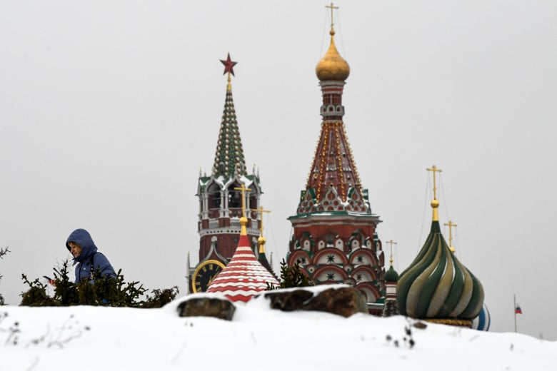 A woman visits the Zaryadye Park, with St. Basil's Cathedral (R) and the Kremlin's Spasskaya Tower (L) seen in the background, in downtown Moscow on December 26, 2017. / AFP PHOTO / Kirill KUDRYAVTSEV        (Photo credit should read KIRILL KUDRYAVTSEV/AFP/Getty Images)