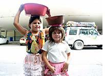 Salvadoran children sell cold drinks to the Drive Around the World team