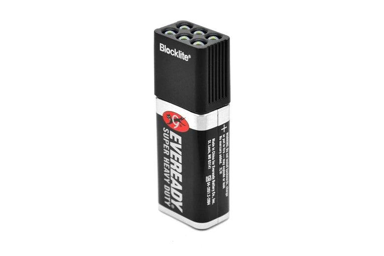 A flashlight that looks like a battery.