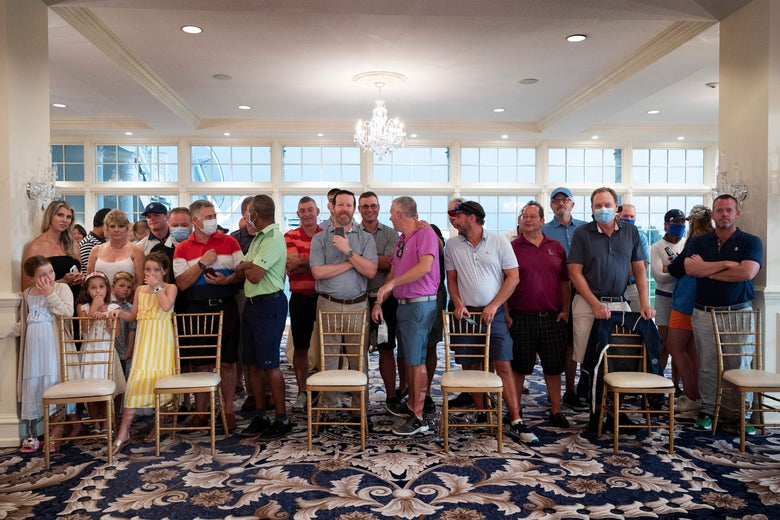 Country club members, few wearing facemasks, await the president's arrival ahead of a news conference in Bedminster, New Jersey, on August 7, 2020.
