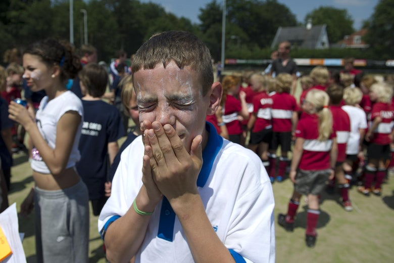 A young boy protects himself with sunscreen during the Laureus Hockey for Good Tournament on June 3, 2011 in Malden, Netherlands.