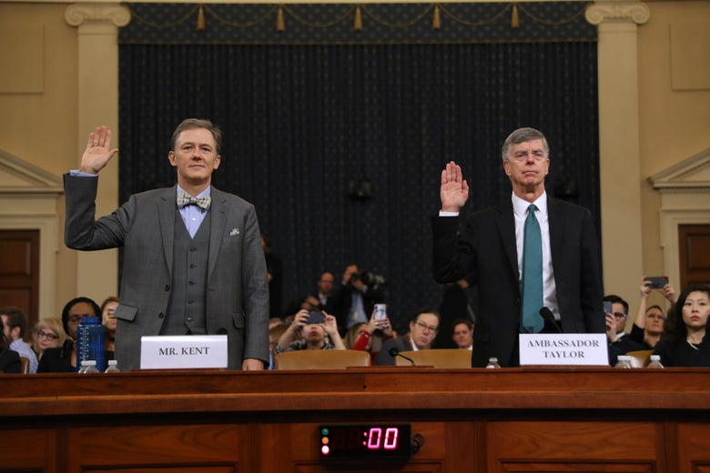George Kent and Bill Taylor raise their hands as they are sworn in.