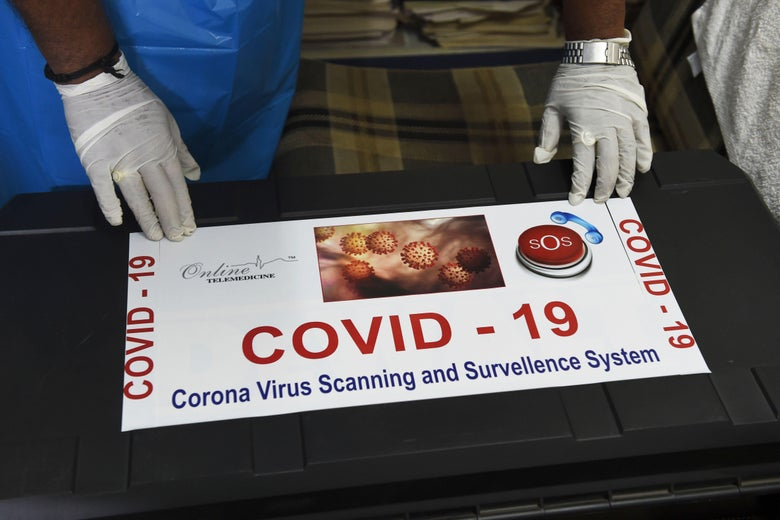 A box labeled COVID-19 scanning system.