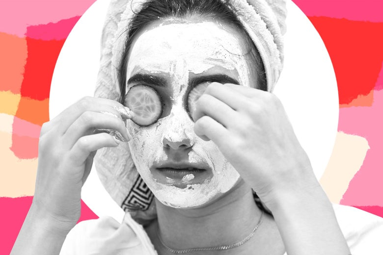 A woman gives herself a facial at home.