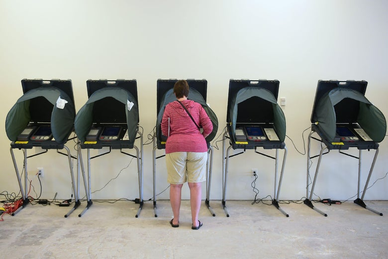 A woman votes at an Early Vote Center in Huntington Beach, California.