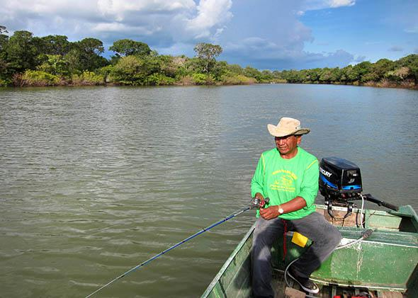 Chief Walter Javaé heads out on an afternoon fishing trip insid,Chief Walter Javaé heads out on an afternoon fishing trip inside the national park, Araguaia National Park, Brazil. February 2015.