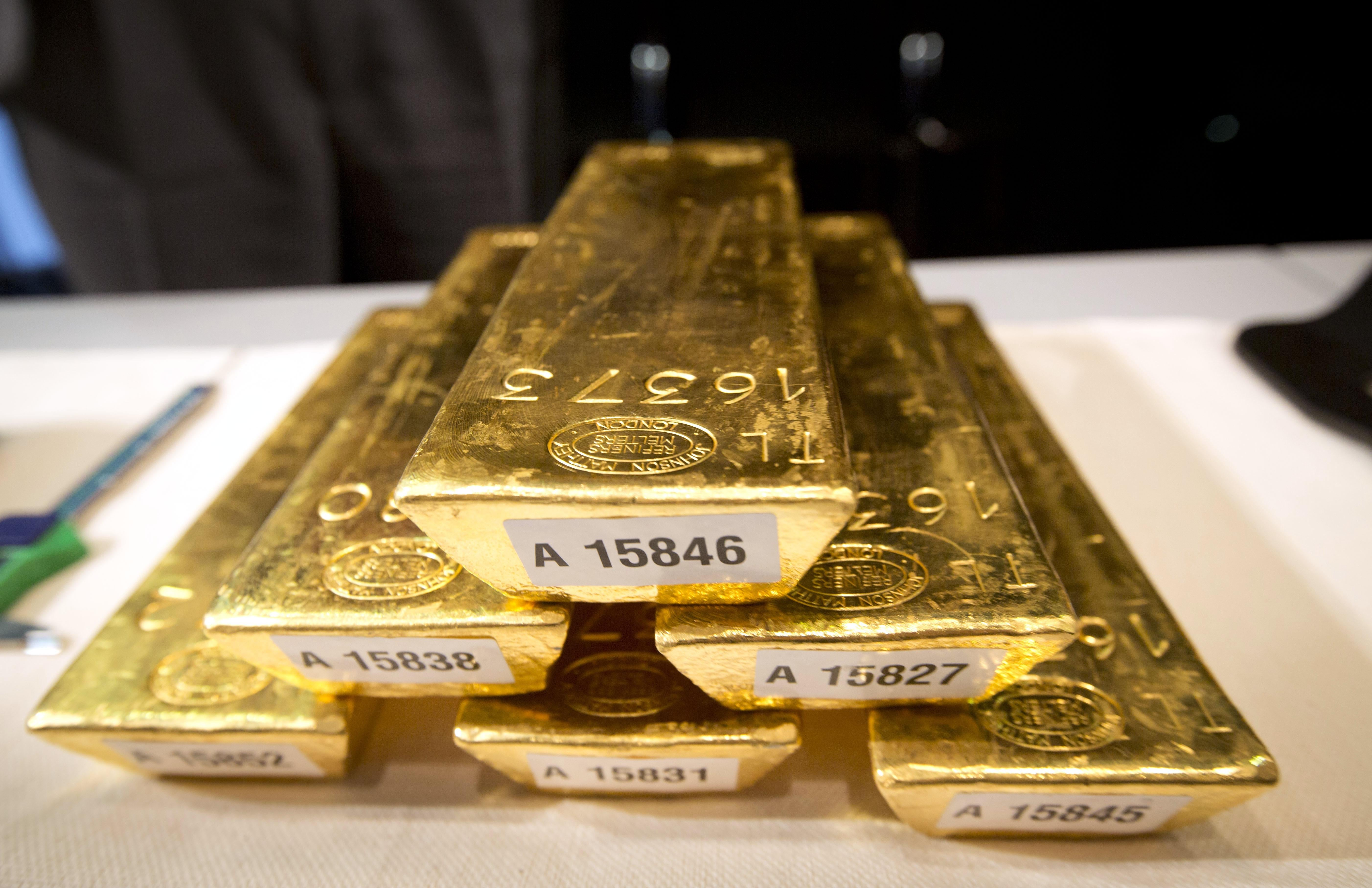 Bars of gold are piled up during a press conference at the German Federal Bank in Frankfurt am Main, Western Germany, on Jan. 16, 2013