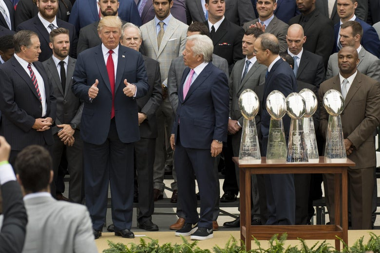 President Donald Trump gives thumbs-up alongside members of the New England Patriots during a ceremony honoring them as 2017 Super Bowl Champions on the South Lawn of the White House on April 19, 2017.