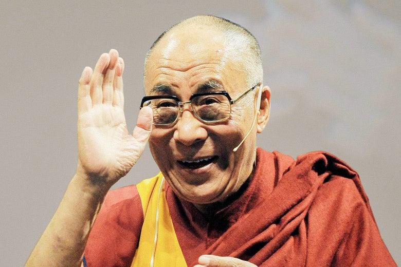 The Dalai Lama waves.