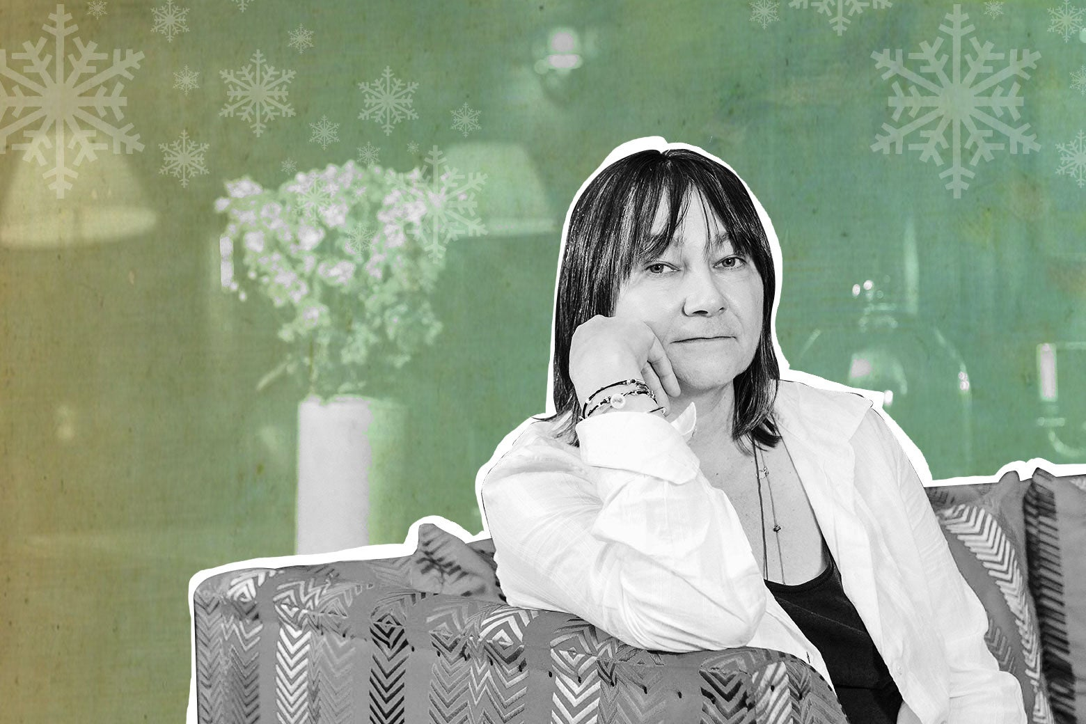 Ali Smith sitting on a sofa.