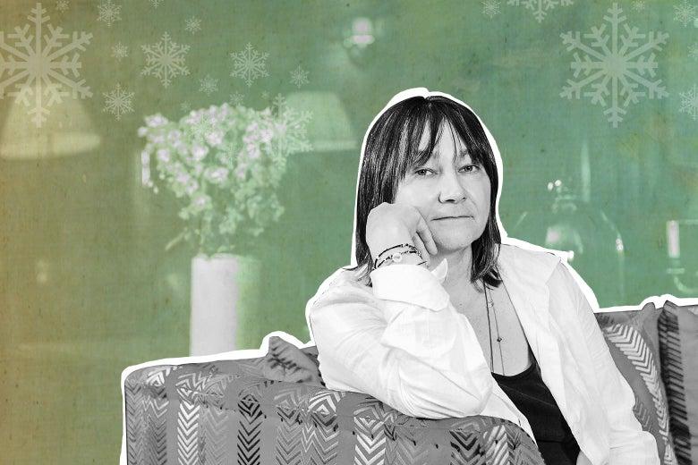 Ali Smith sitting on a sofa.