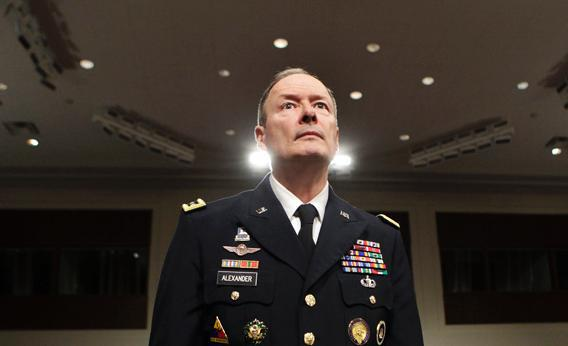 General Keith Alexander, commander of the U.S. Cyber Command, director of the National Security Agency and chief of the Central Security Service, arrives at the Senate Appropriations Committee hearing on Cybersecurity: Preparing for and Responding to the Enduring Threat, on Capitol Hill in Washington June 12, 2013.