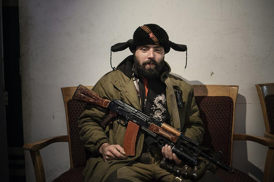 A pro-Russian rebel relaxes in a bunker close to the airport in Donetsk.