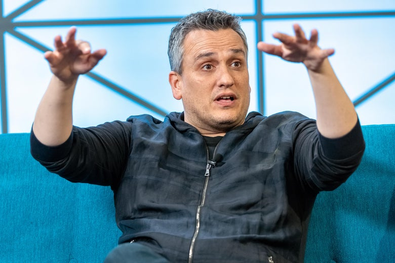 Joe Russo gestures while talking at an event.