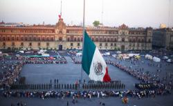 Mexican flag in plaza, Mexico City.