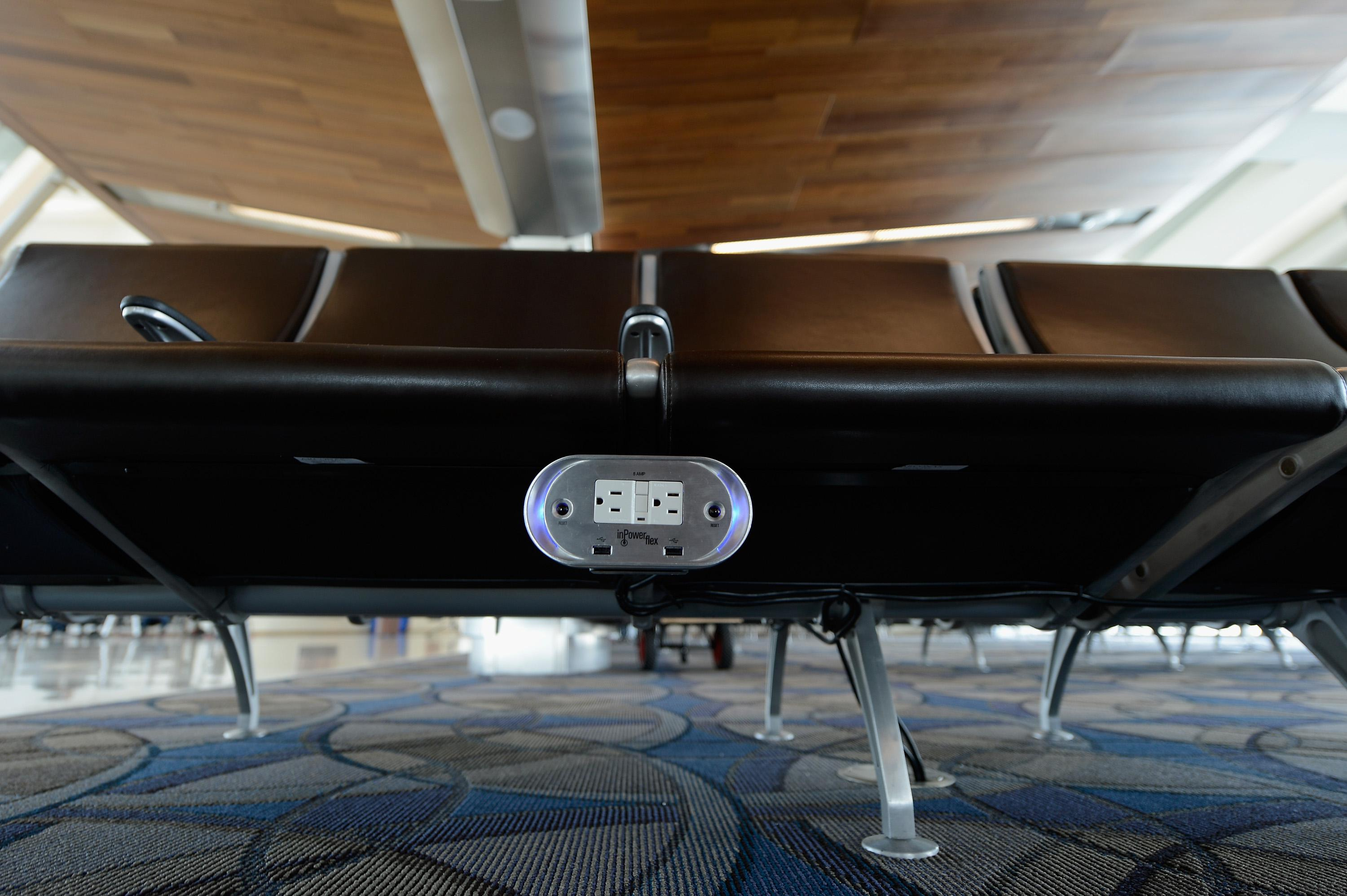 Power outlets are placed under every bench of the new north concourse the Tom Bradley International Terminal at Los Angeles International Airport.