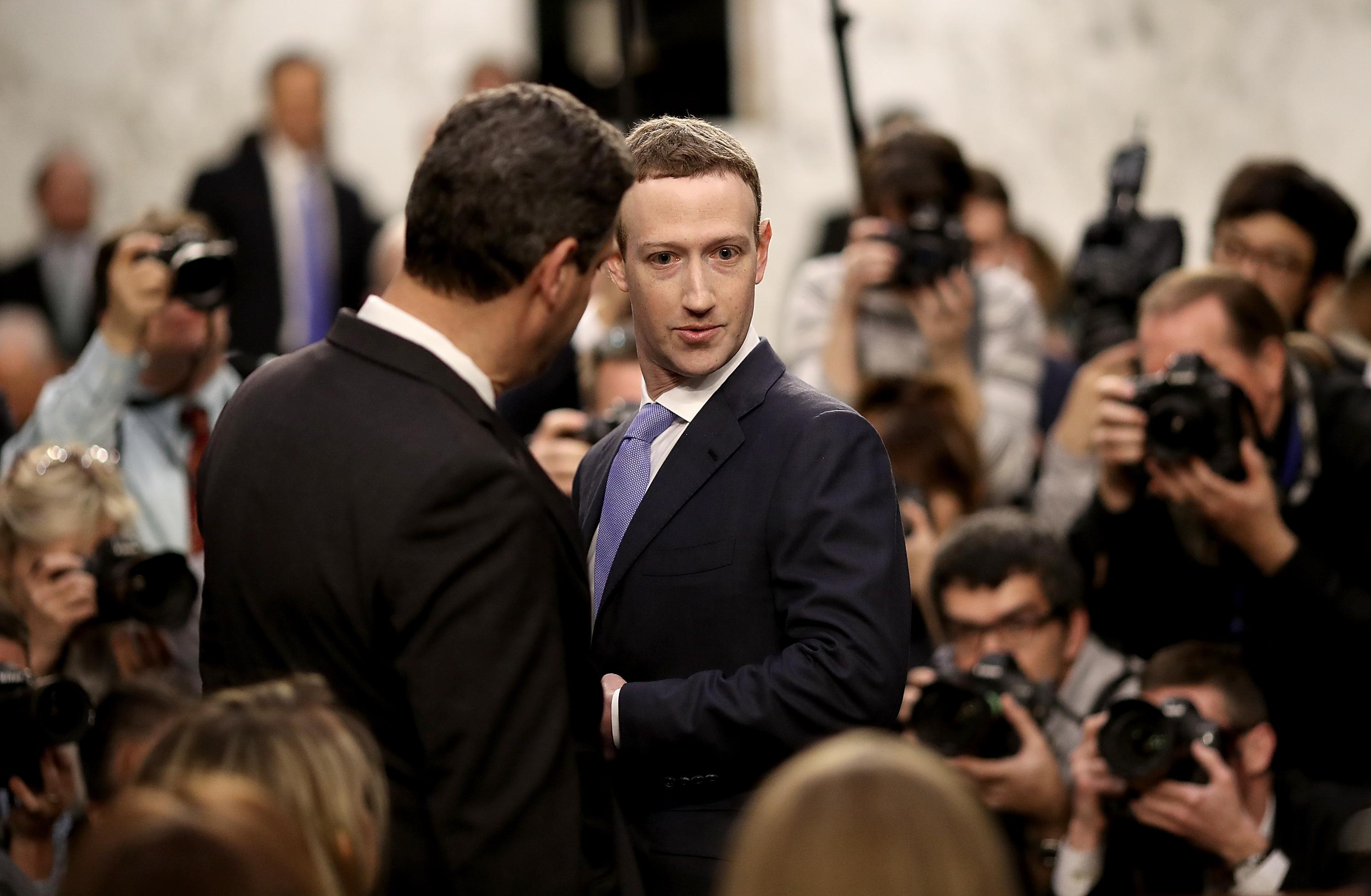 WASHINGTON, DC - APRIL 10:  Facebook co-founder, Chairman and CEO Mark Zuckerberg (R) arrives to testify before a combined Senate Judiciary and Commerce committee hearing in the Hart Senate Office Building on Capitol Hill April 10, 2018 in Washington, DC. Zuckerberg, 33, was called to testify after it was reported that 87 million Facebook users had their personal information harvested by Cambridge Analytica, a British political consulting firm linked to the Trump campaign.  (Photo by Win McNamee/Getty Images)