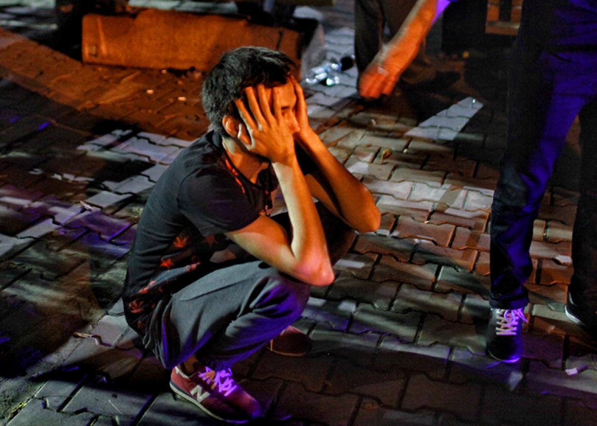 A relative of the Ataturk Airport suicide bomb attack victim wait dejectedly outside Bakirkoy Sadi Konuk Hospital, in the early hours of June 29, 2016 in Istanbul, Turkey.
