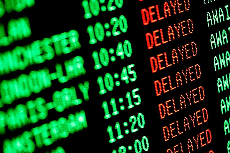 A departures and arrivals board in an airport, with many delays.