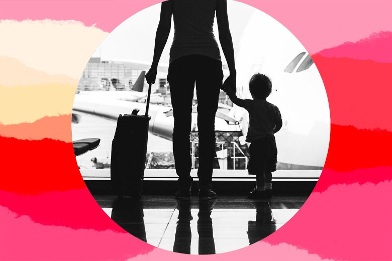 A mother and toddler hold hands in an airport terminal.