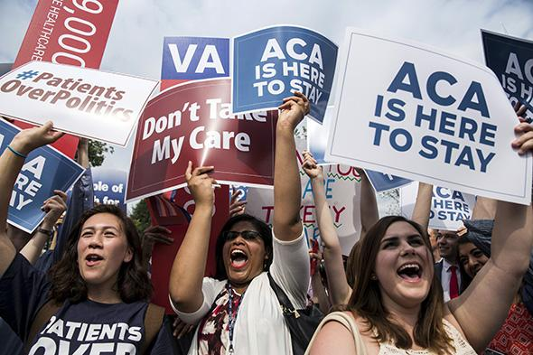 Supporters of the Affordable Care Act celebrate after the Supreme Court upheld the law in a 6–3 vote at the Supreme Court in Washington, D.C., on June 25, 2015