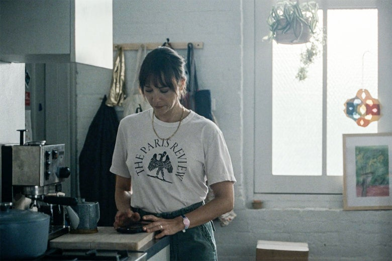 Rashida Jones stands in her light-filled kitchen, wearing a Paris Review T-shirt