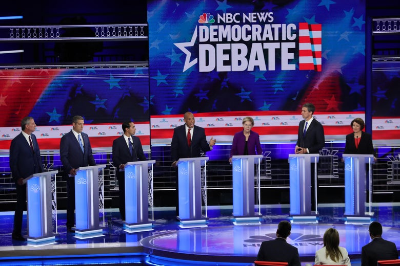 Bill de Blasio, Tim Ryan, Julian Castro, Cory Booker, Elizabeth Warren, Beto O'Rourke, and Amy Klobuchar on the debate stage.