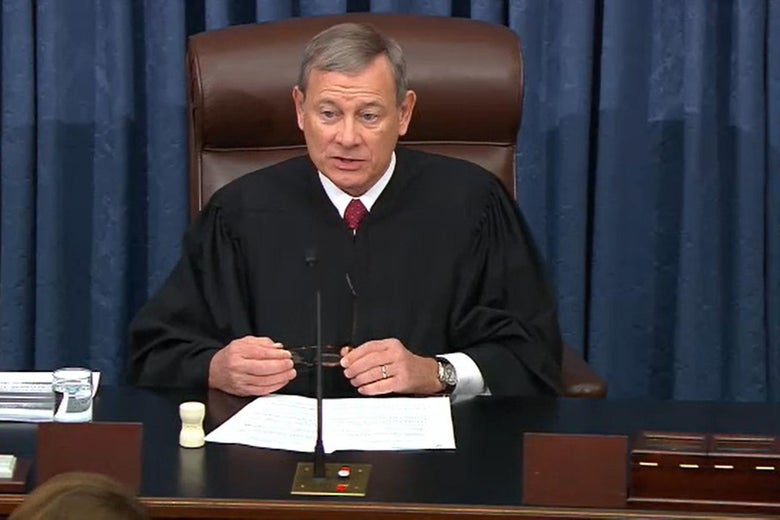 John Roberts in his robes, seated and addressing the Senate.