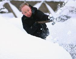 A man shovelling snow.