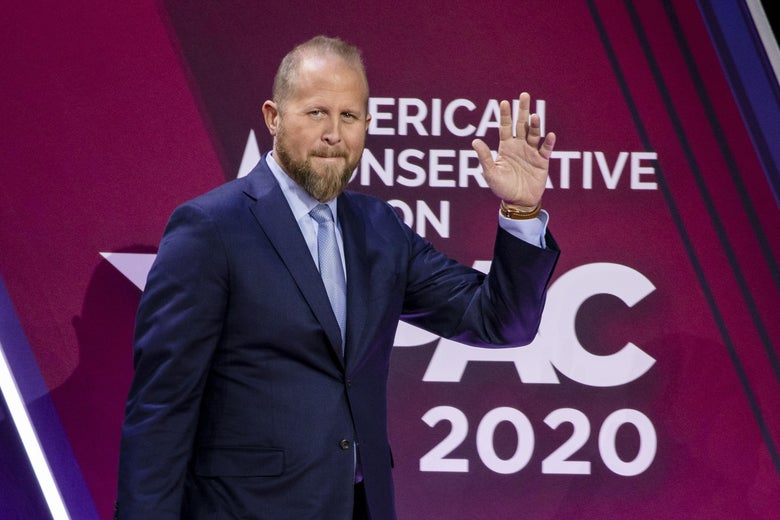Brad Parscale waves while walking on stage in a suit during the Conservative Political Action Conference 2020.