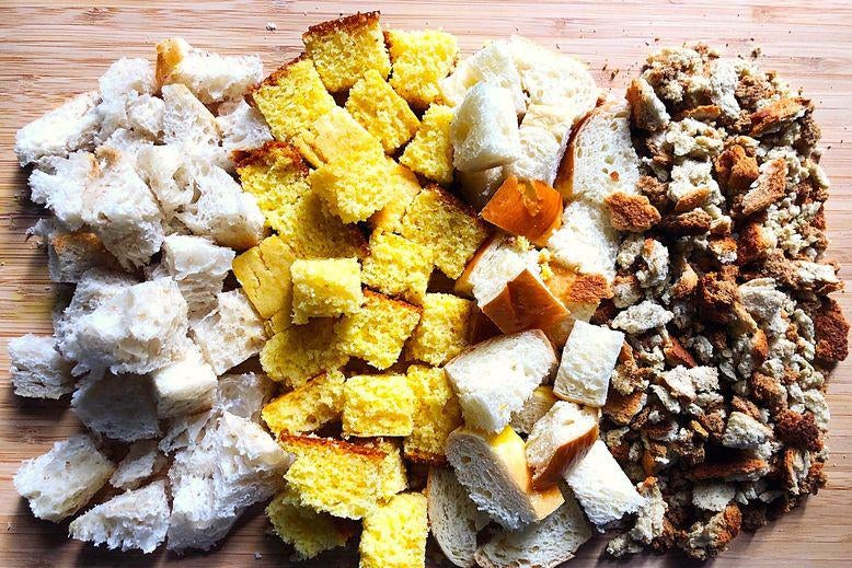 Square chunks of different kinds of bread, ranging from fine stuffing mix to thick, yellow cornbread.