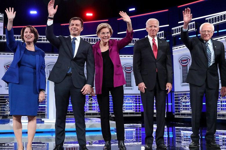 Amy Klobuchar, Pete Buttigieg, Elizabeth Warren, Joe Biden, and Bernie Sanders wave on the debate stage.